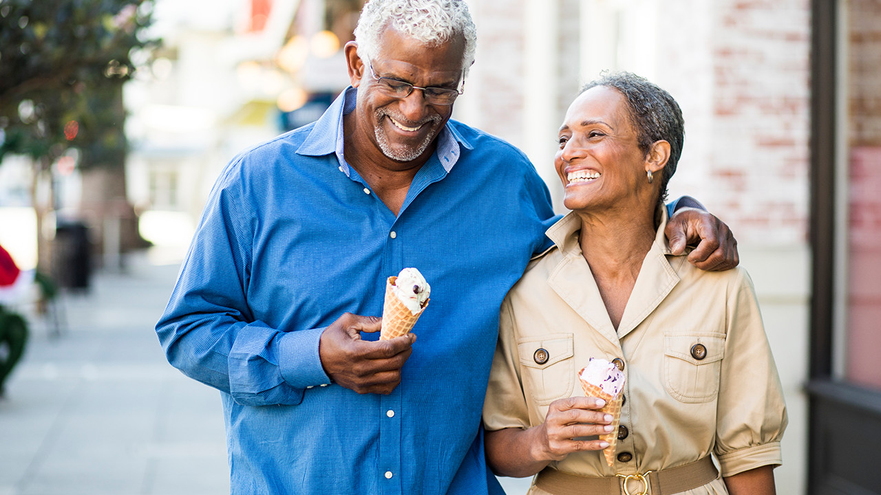Older couple walking with ice cream_Banner_Block_1280px