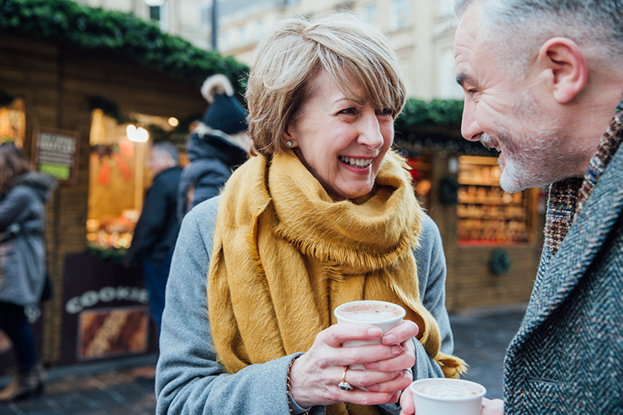 older_couple_enjoying_coffee_out_and_about_Banner_Block_2120px