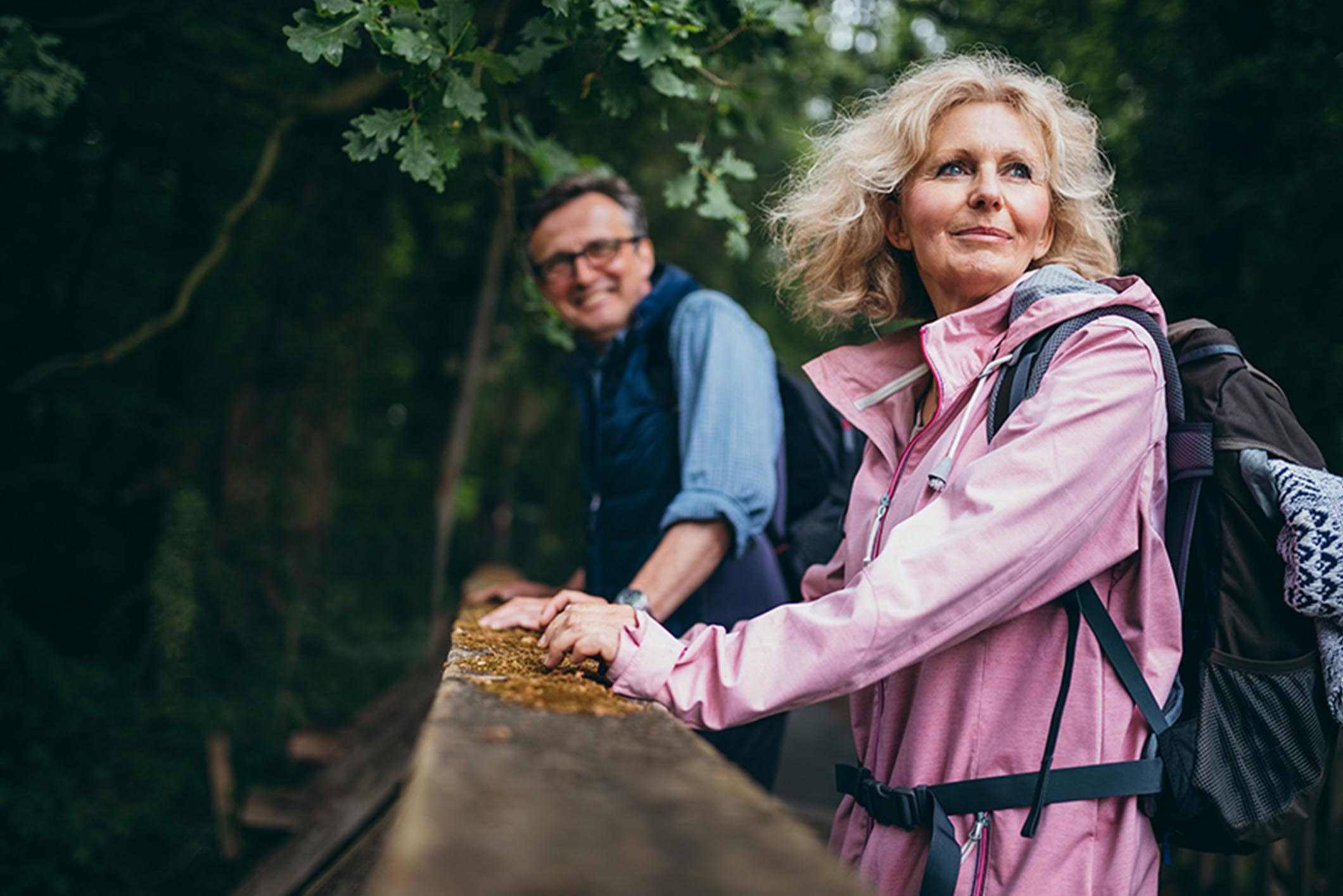 older_couple_walking_in_woods_Banner_Block_2120px