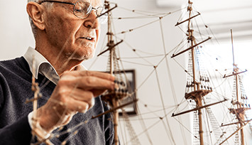 elderly-man-with-model-ship_Feature_box_355px
