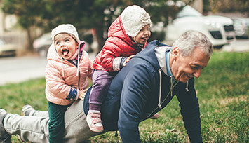 grandad_doing_pressups_with_grandchildren_on_top_Feature_box_355px