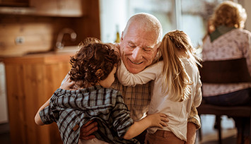 grandad_hugging_grandchildren_Feature_box_355px