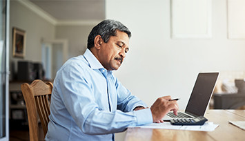 middle-aged-man-at-dining-table-on-laptop_Feature_box_355px