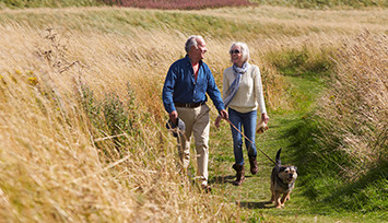 older-couple-taking-dog-for-walk_Feature_box_355px