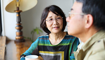 older_asian_couple_discussion_over_tea_Feature_box_355px