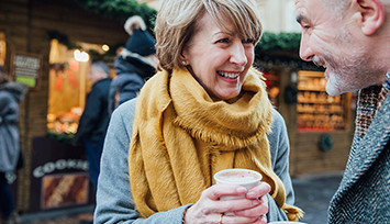 older_couple_enjoying_coffee_out_and_about_Feature_box_355px