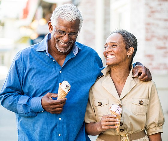 Older Couple Walking With Ice Cream