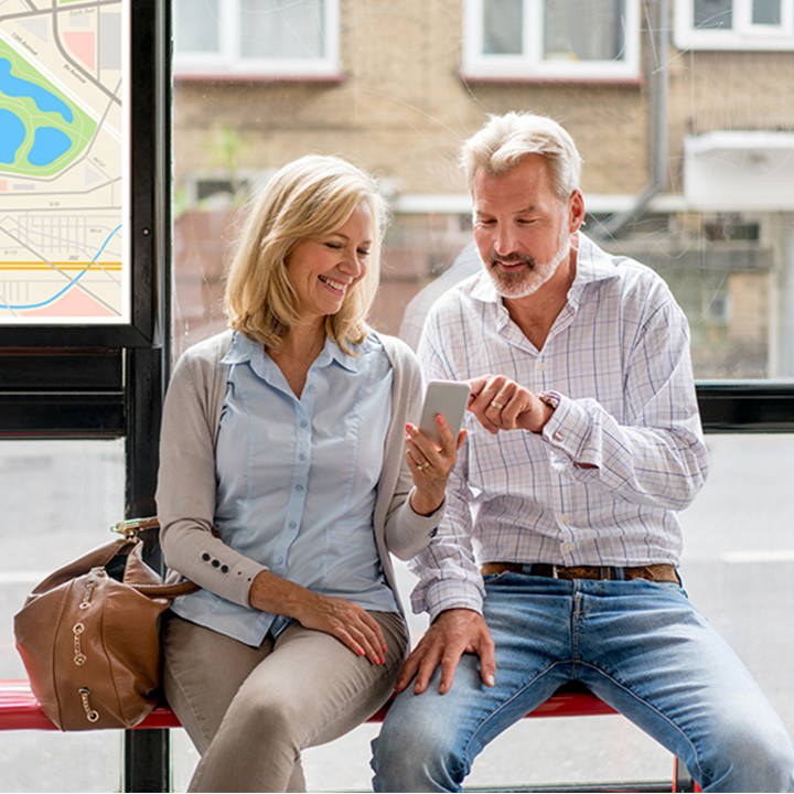 middle_aged_couple_on_phone_at_bus_stop_square&cirle_720px