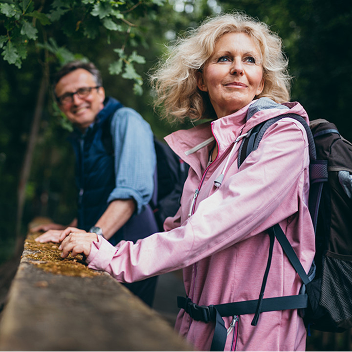 older_couple_walking_in_woods_square&cirle_720px
