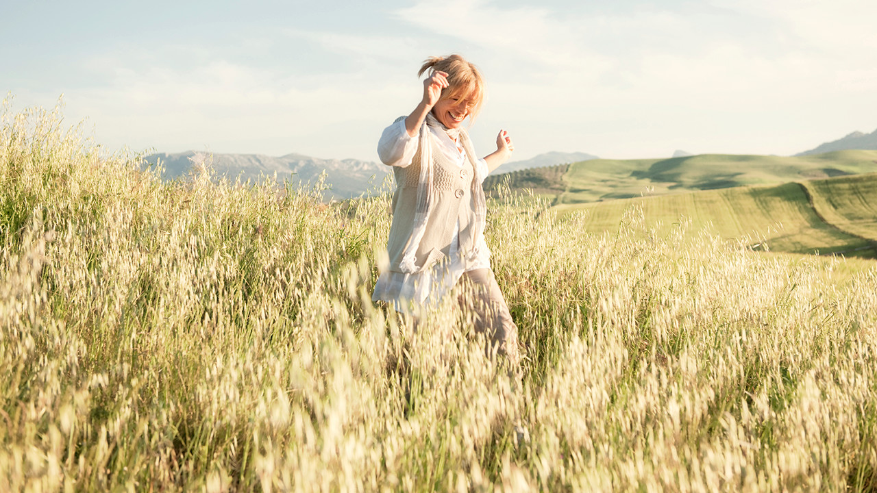 woman running in field_Banner_Block_1280px