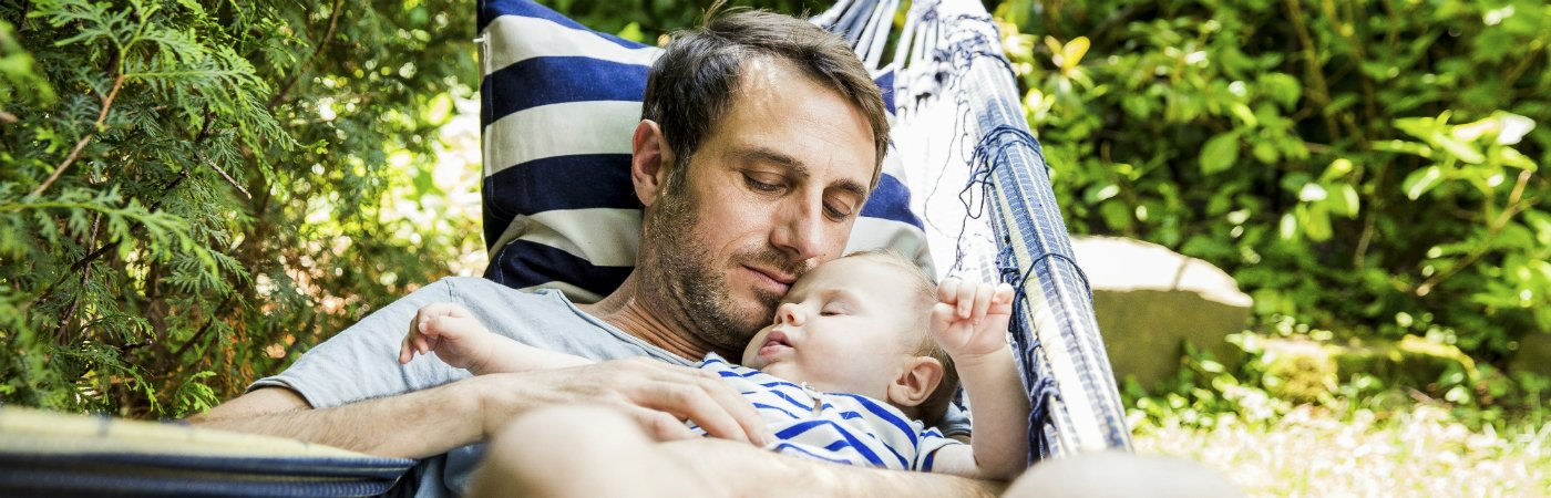 Sleep tips for parents - father and son in hammock