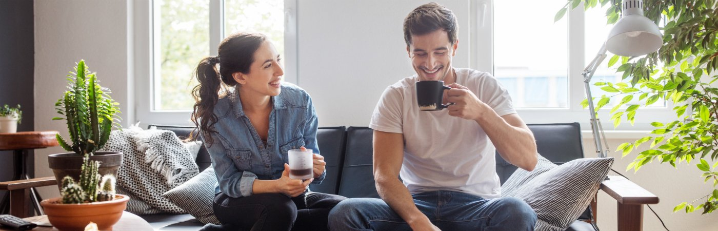 Couple sat in coffee shop deciding whether to get single or joint life insurance