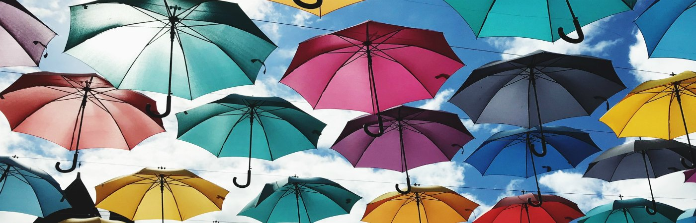 how many life insurance policies - umbrellas in sky