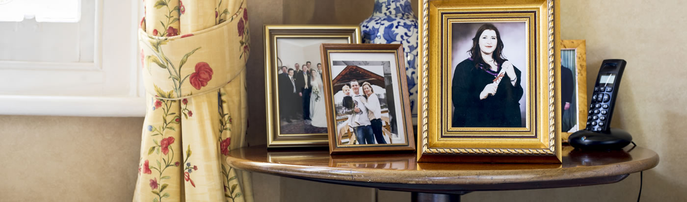 Picture of family in frames on the table