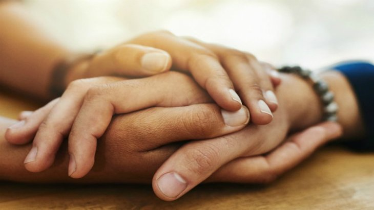 life cover - resources - img - coping with a terminal illness - holding hands - 730x411