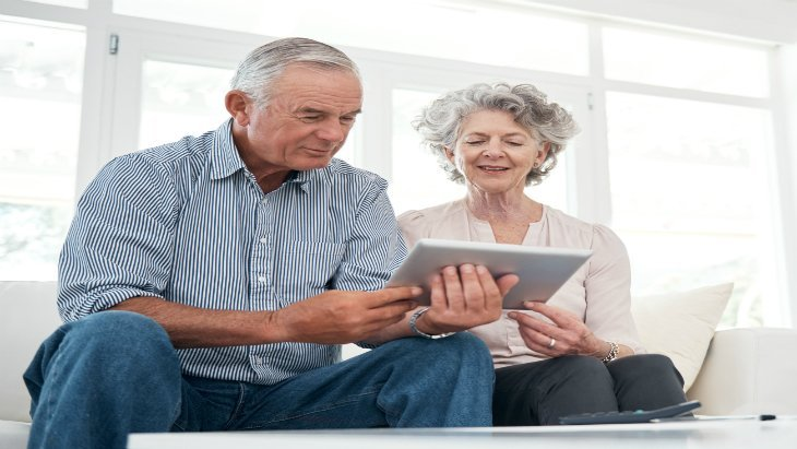 consumer - over 50s - IMAGE - Article Couple using I pad 730 X 411